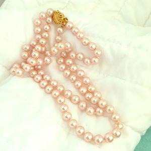 Pink glass pearls. Secure gold filigree closure